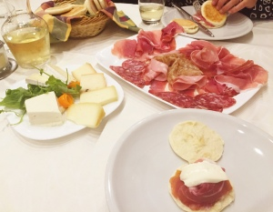 Traditional Modenese cuisine: tigelle with scrumptious meats & cheeses